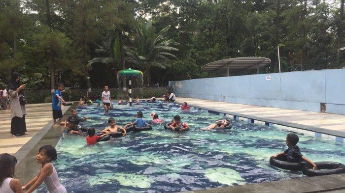 Mandi-mandi di Taman Lalu Lintas via Tribunnews
